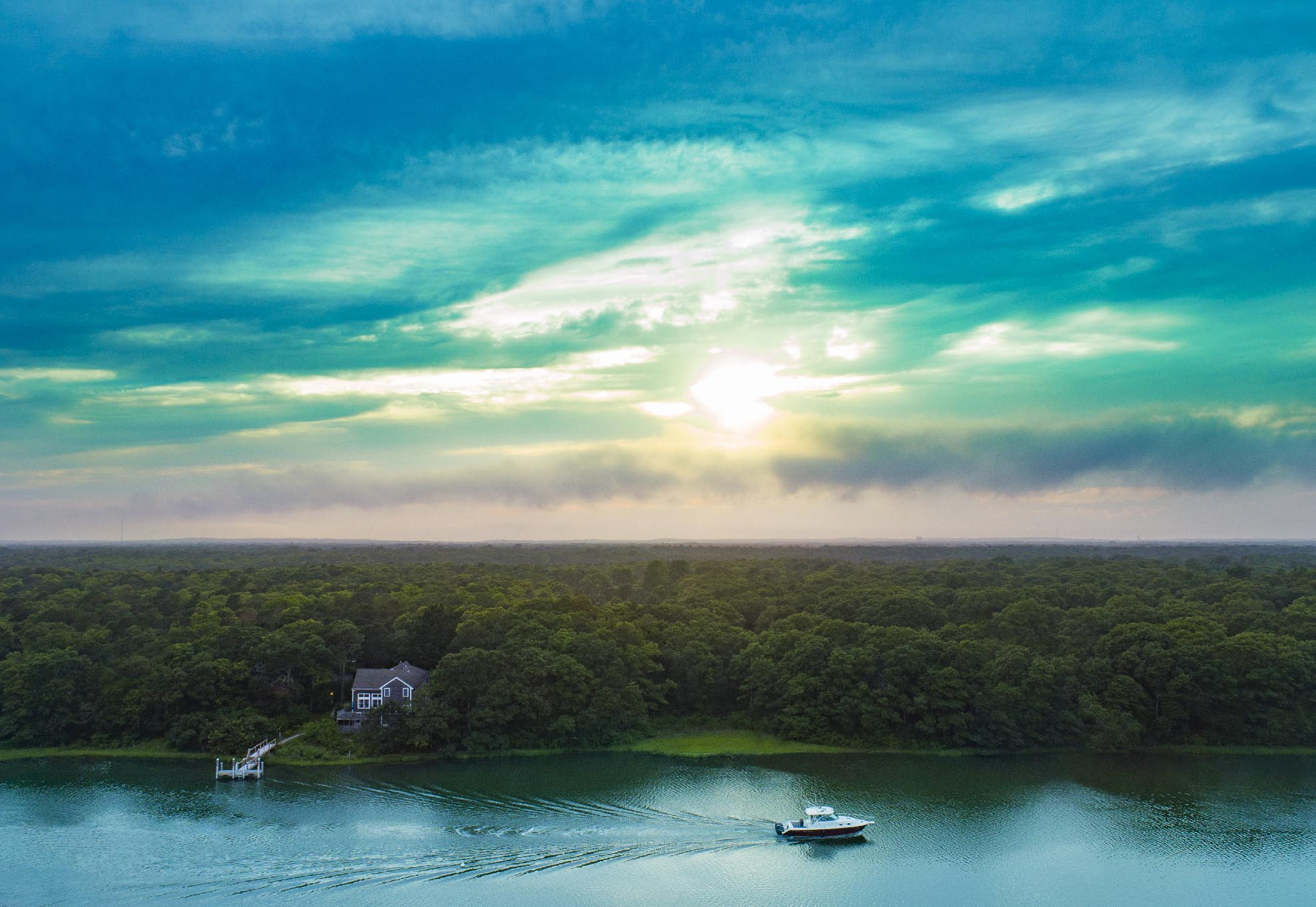 Drone Photograph of Boat going up inlet in East Falmouth at Sunset
