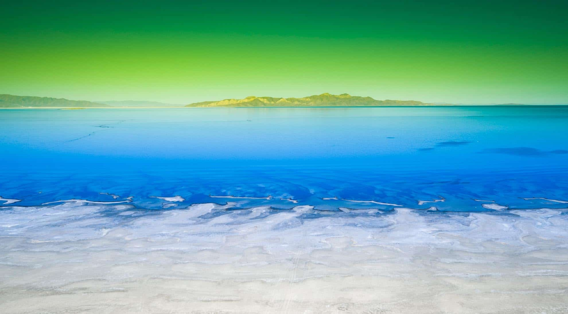 Drone Photograph of The Great Salt Lake with a green sky