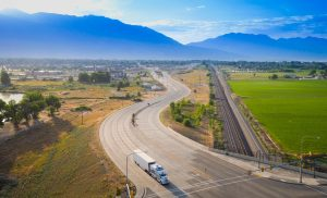 Drone Photograph of Moving truck in the morning with Wasatch Mountains in the background