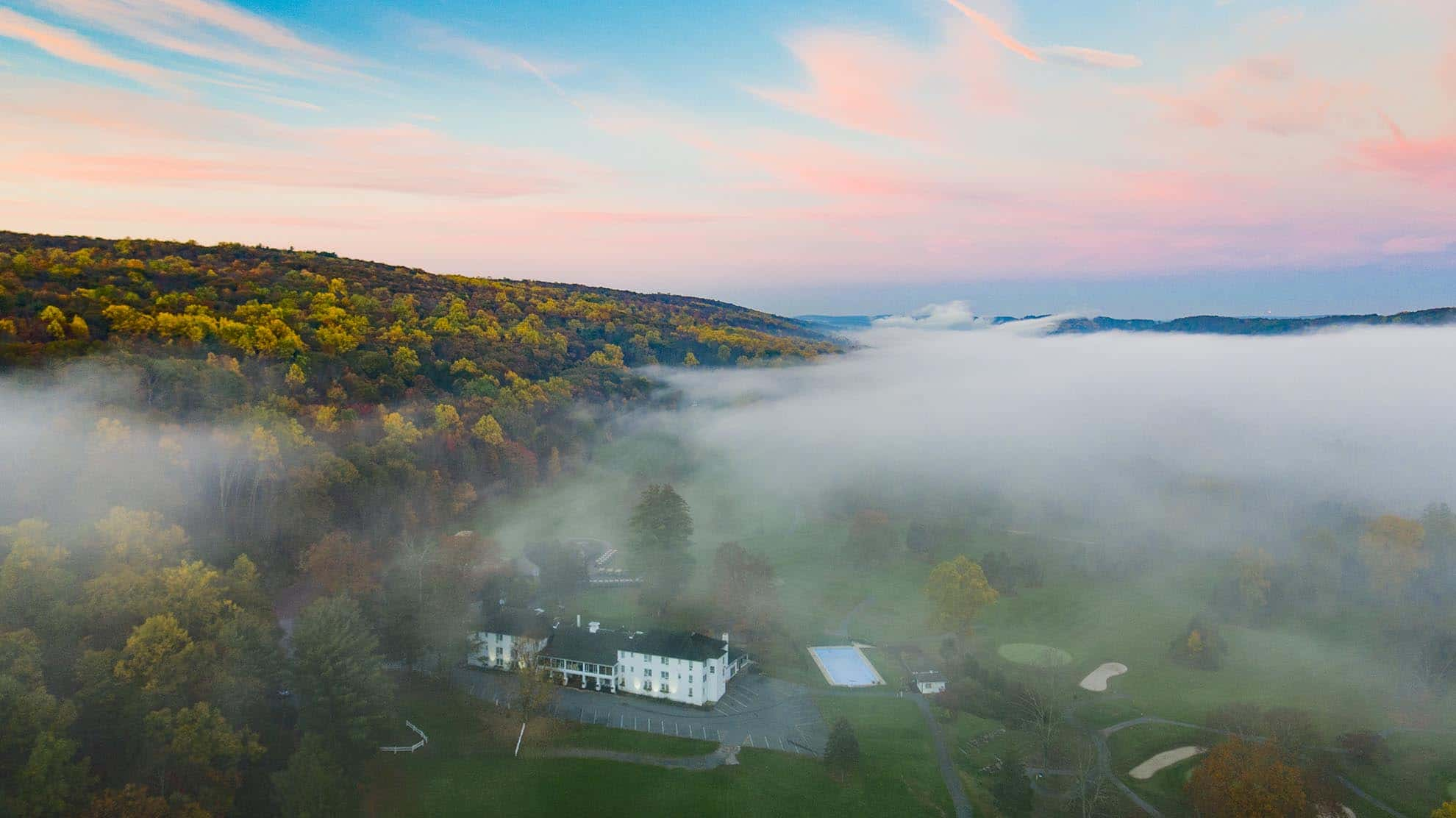 Drone photgraph of morning fog over Water Gap Country Club in Autumn