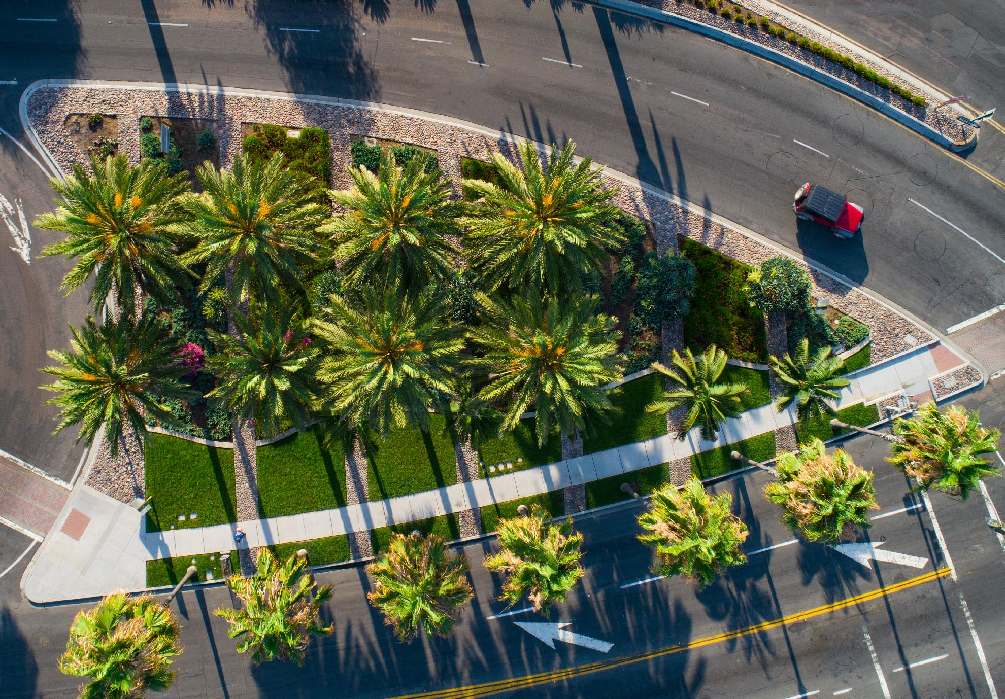 Drone Photograph of birds eye view of Red Jeep at Intersection in California