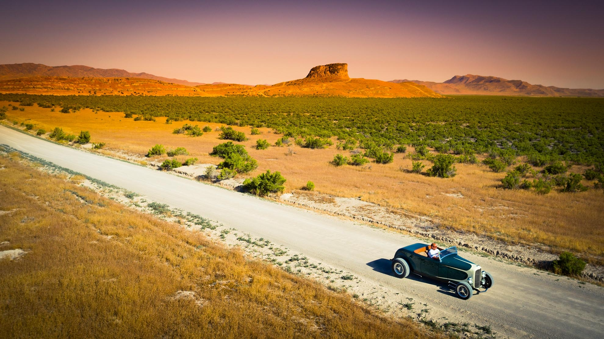 Drone Photograph of Racer Ray in Hot Rod on dirt road in Utah Desert