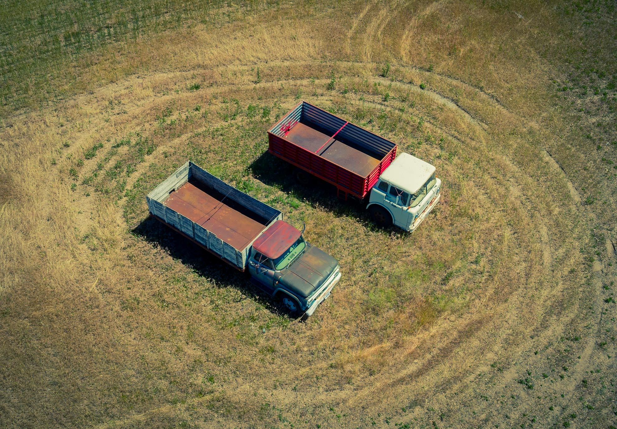 Drone Photograph of Farm Trucks in Utah Field