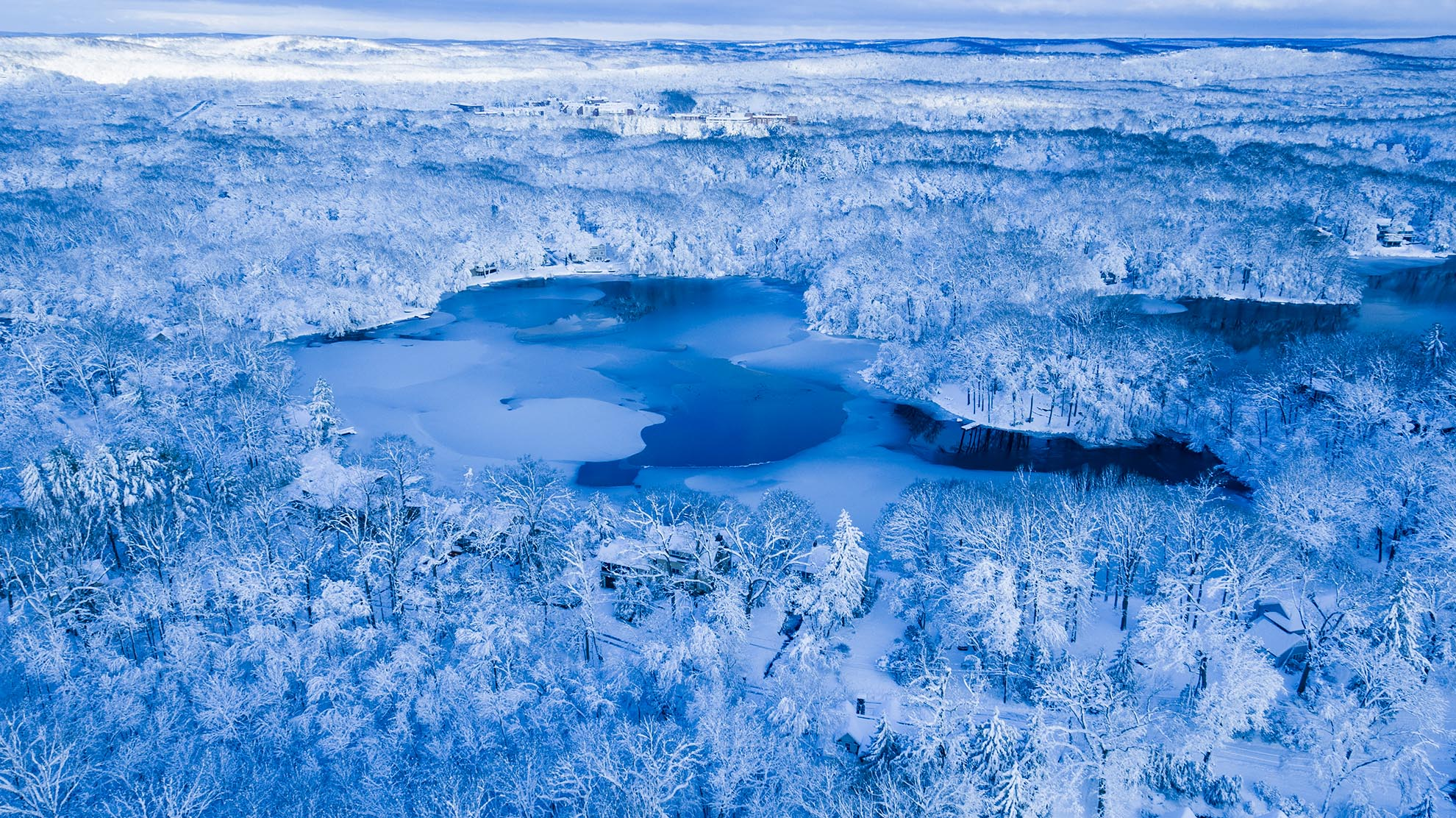 Photograph of Sunset Lake Mountain Lakes NJ after snow storm from a drone