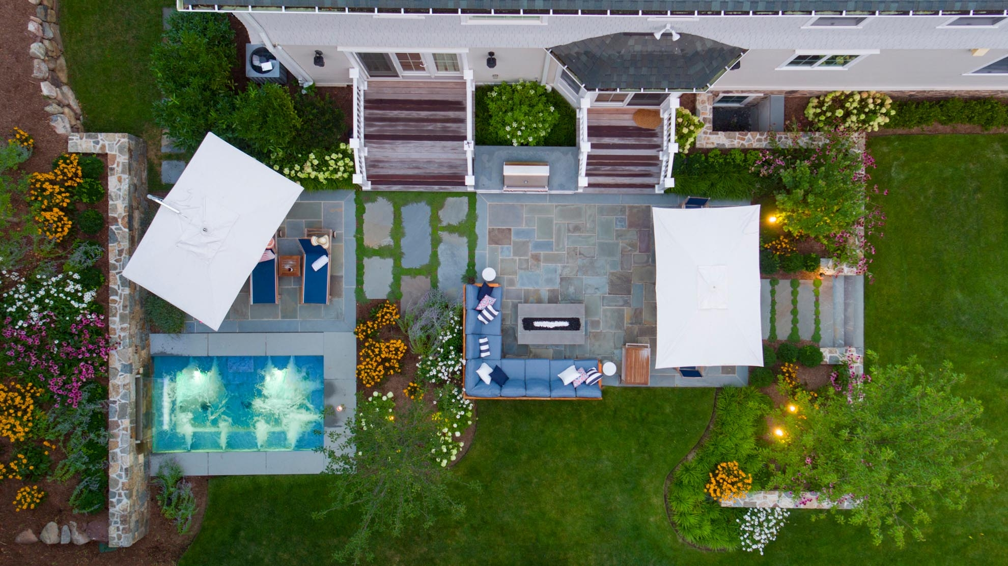 Drone Photograph of a birds eye view of a back yard Spa