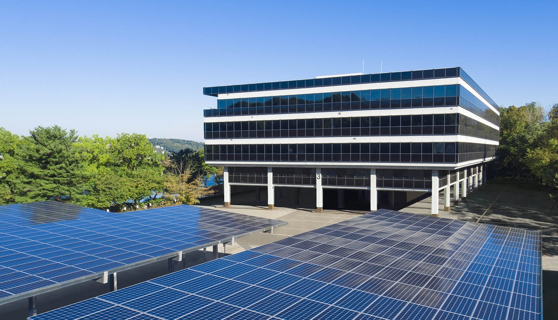 Drone Photograph taken of Commercial Building with Solar Panel Parking Lot in New Jersey