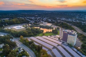 Drone Photograph taken of Commercial Buildings with Solar Panel Parking Lot in New Jersey