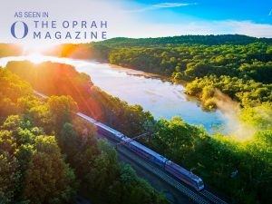 Photograph of Lake Estling NJ with commuter train going by at sunrise taken with a drone