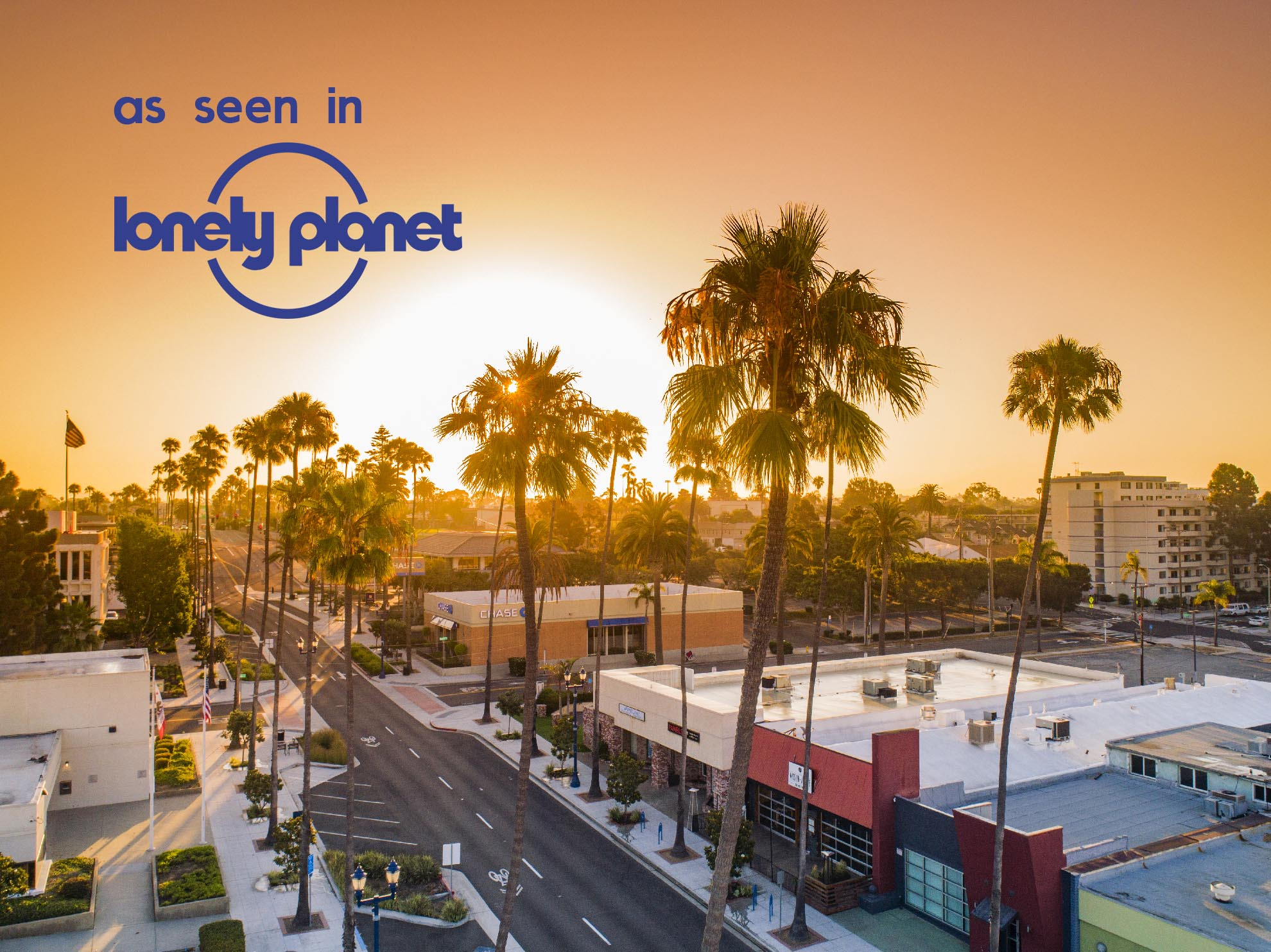 Drone photograph of Oceanside Center at Sunrise with Lonely Planet Logo