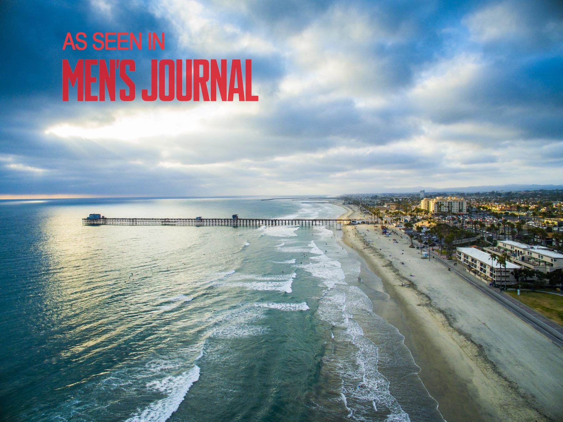 Drone Photograph of Oceanside Pier at Sunset with Mens Journal Logo