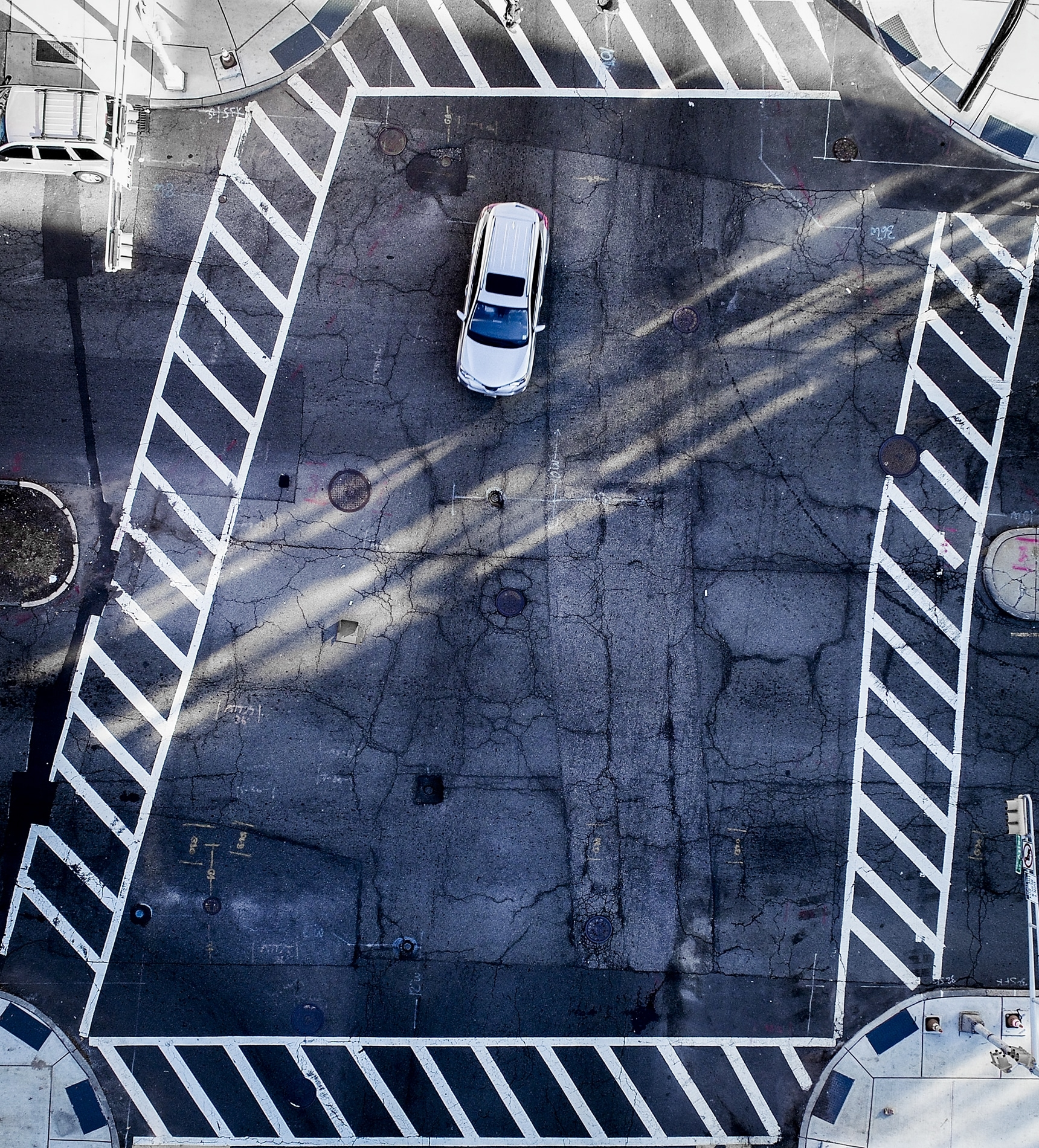 Drone Photograph taken of a car in an intersection in Newark New Jersey