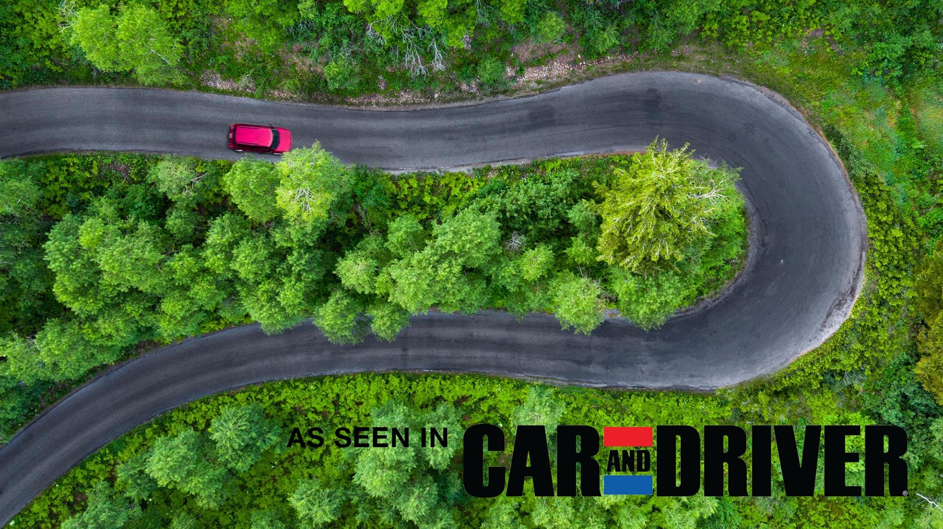 Drone Photograph of a red car on a Horse shoe road in UTAH