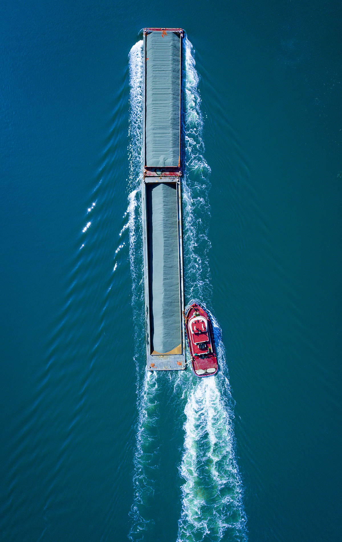 Drone Photograph Nadir angle of a barge going up the Arthur Kill Waterway in New Jersey
